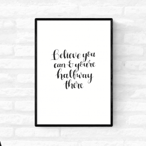 "Framed wall quote print with the words ""Believe you can and you're halfway there"" in black and white colour"
