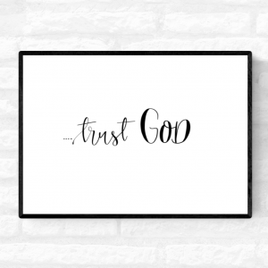 "Framed wall quote print with the word ""Trust God"" written across the middle"