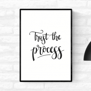 "Framed wall quote print with the words ""Trust the process"", in black and white colour"